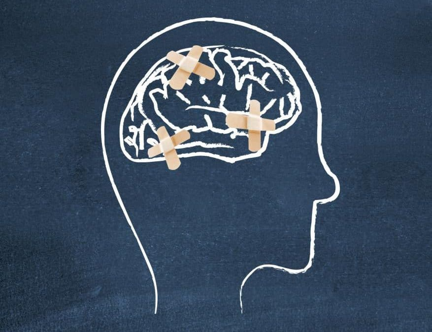 mental health portrayed via image of a head drawn on a chalkboard with band-aids on the brain
